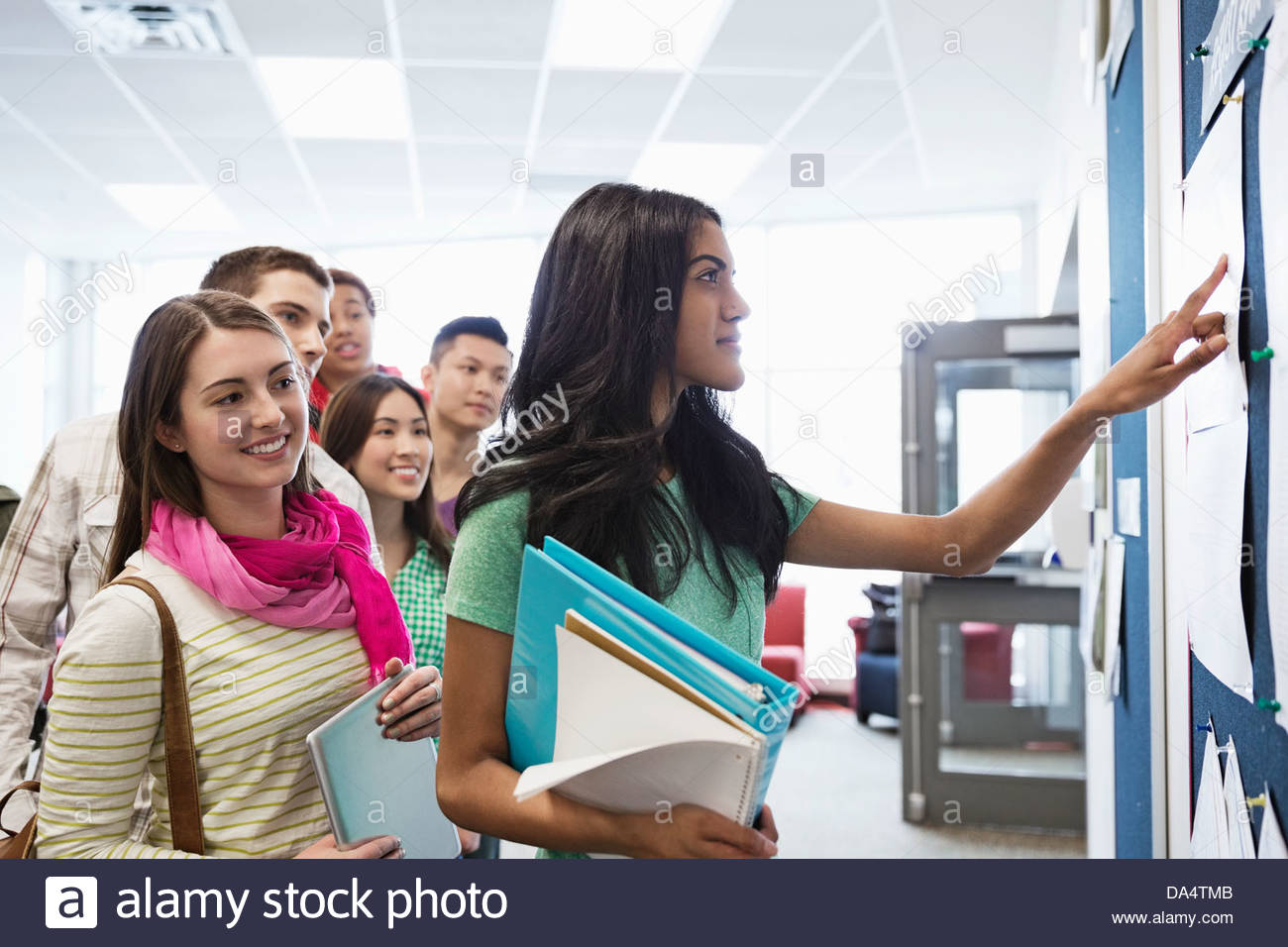 Group of college students checking grade postings - Stock Image