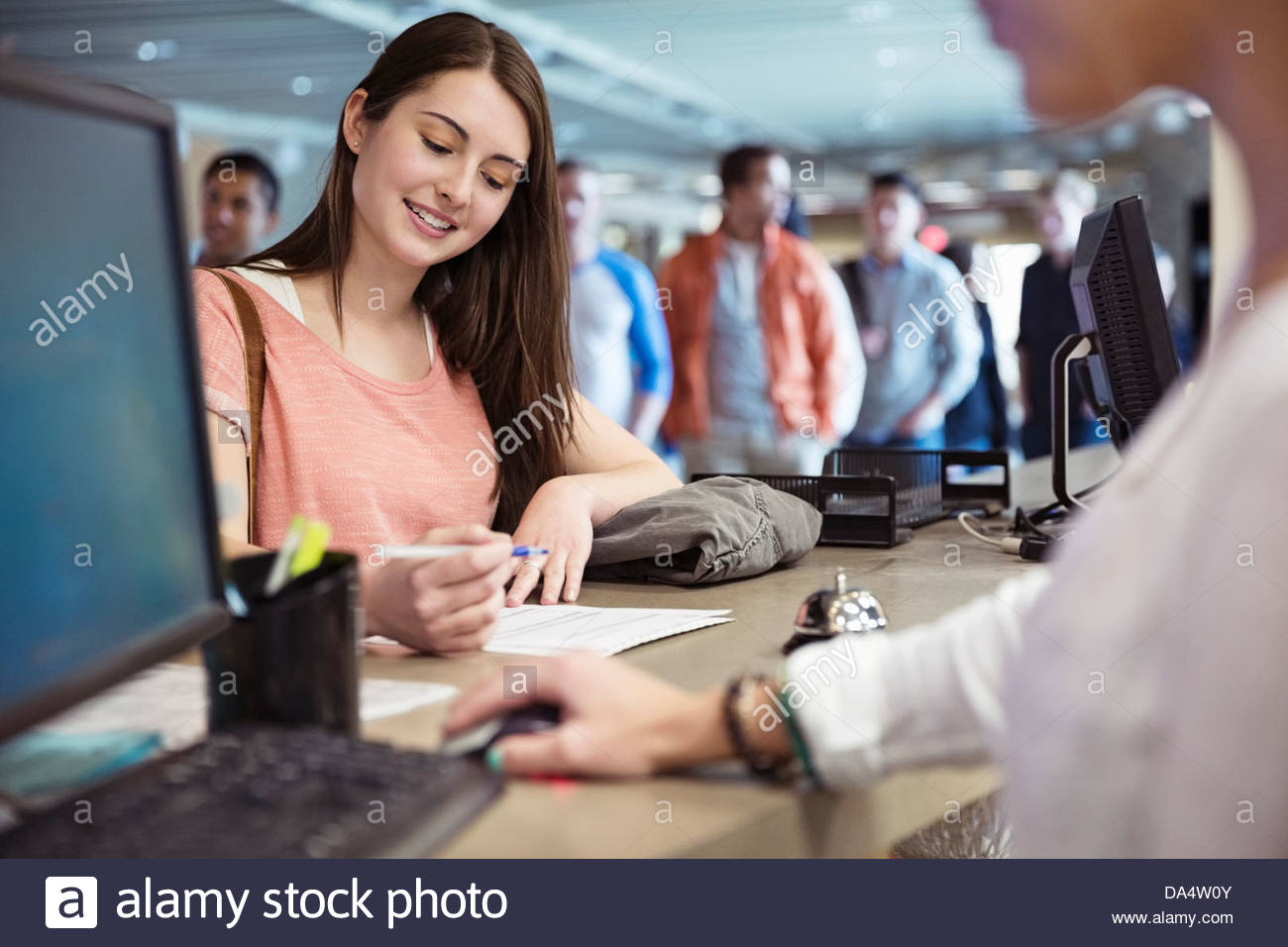 Young students registering for classes at college campus - Stock Image