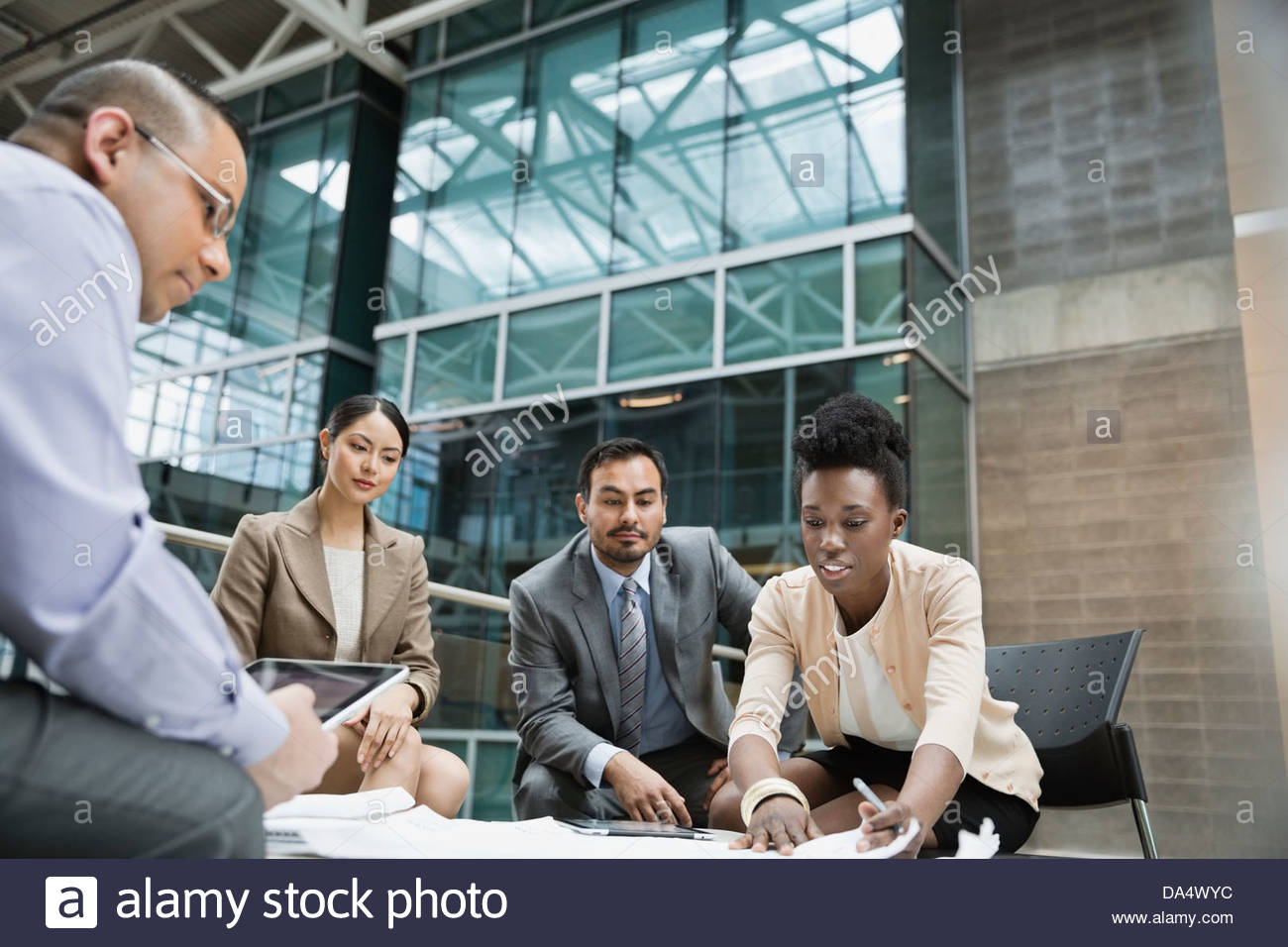 Businesspeople having meeting in office building - Stock Image