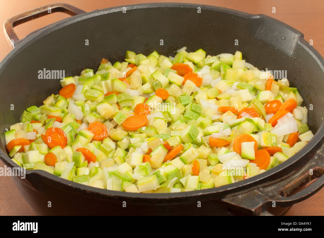 quenching of diced of vegetables to saute closeup - Stock Image