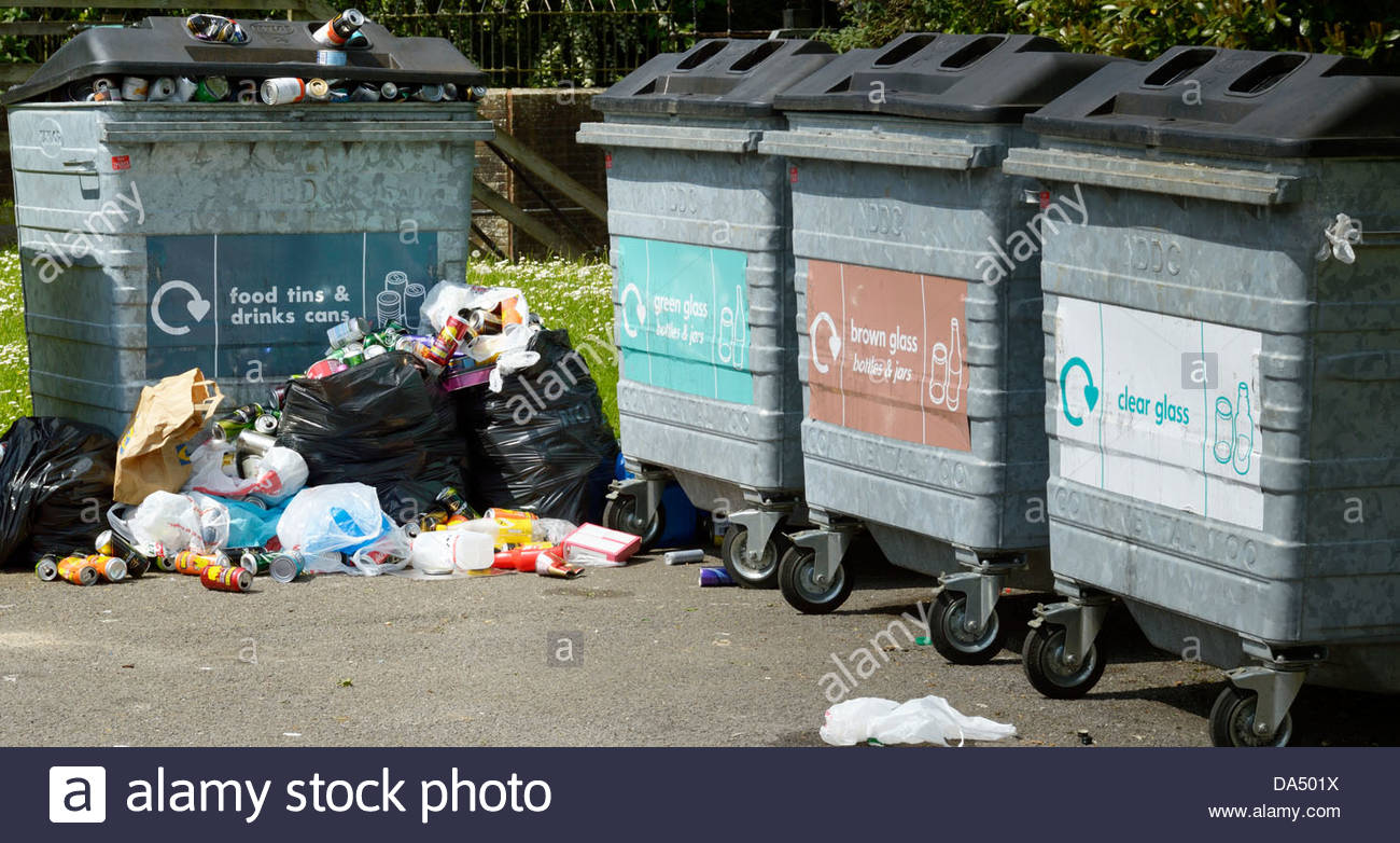 Overflowing rubbish at a small recycling centre - Stock Image