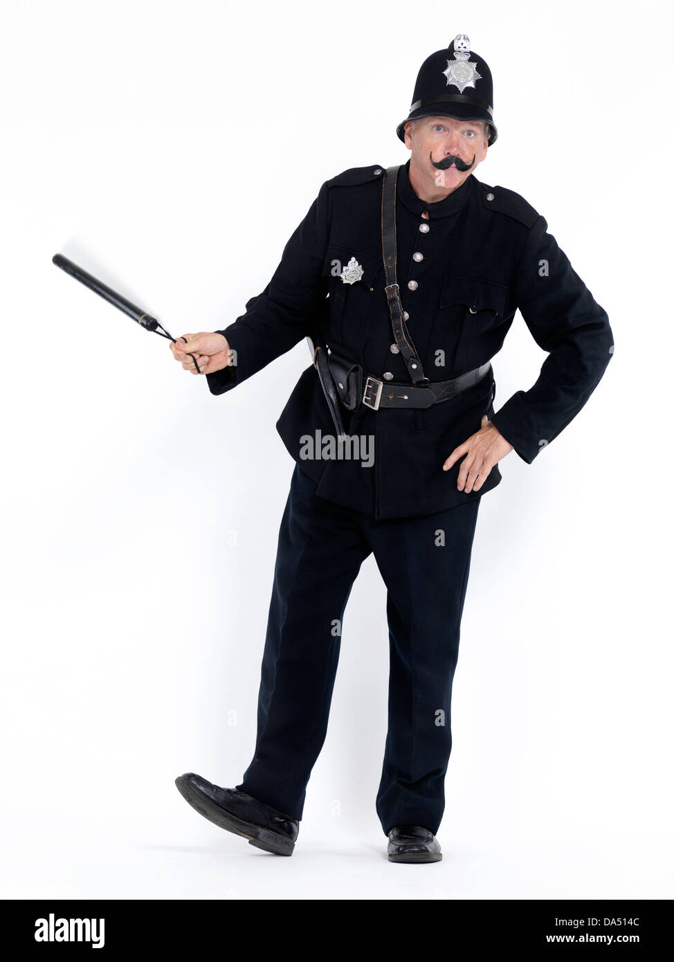 Vintage policeman character spinning a baton, isolated on white background - Stock Image