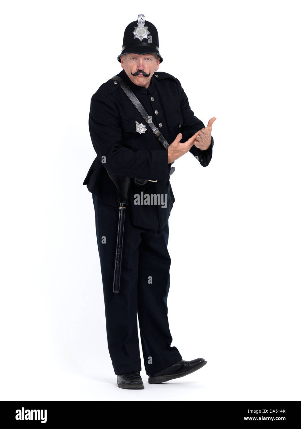 Vintage police officer with serious expression demanding a proof or documents, humorous conceptual portrait isolated - Stock Image