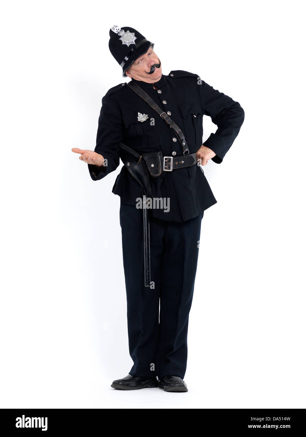Police officer in vintage uniform with a stretched arm and serious expression demanding documents, humorous conceptual - Stock Image