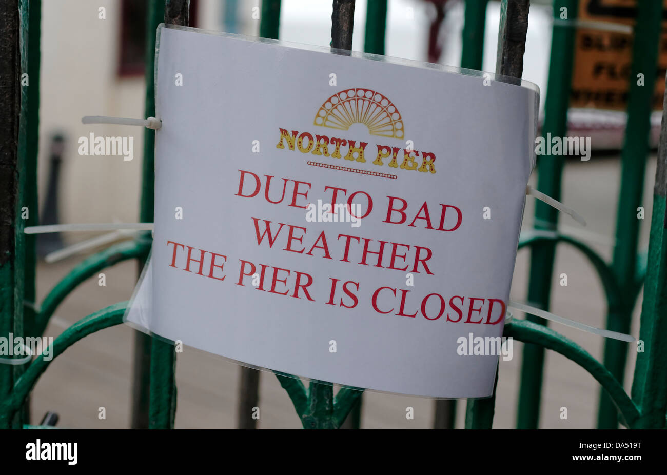 Pier Closed sign due to bad weather, out of season in Blackpool - Stock Image