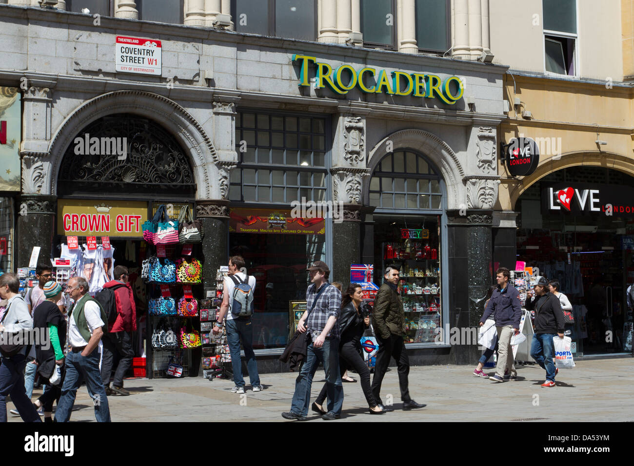 People walking along Coventry Street by the Trocadero centre, Londons West End, England, UK - Stock Image