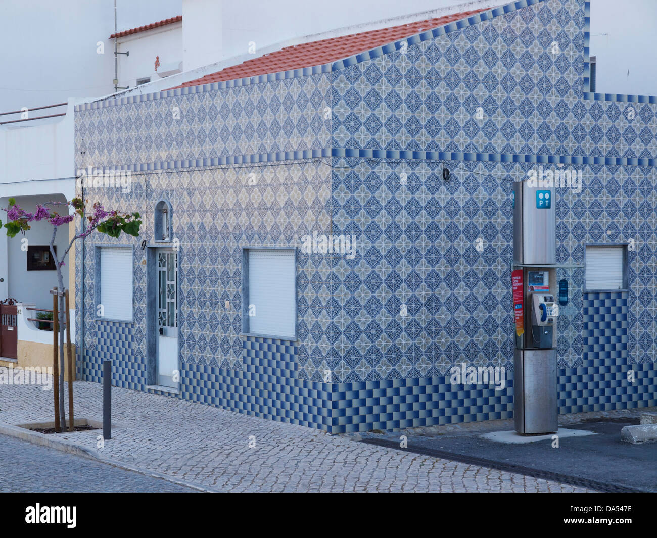modern house completely clad in traditional azulejos tiles in Cabanas de Tavira, Algarve, Portugal - Stock Image