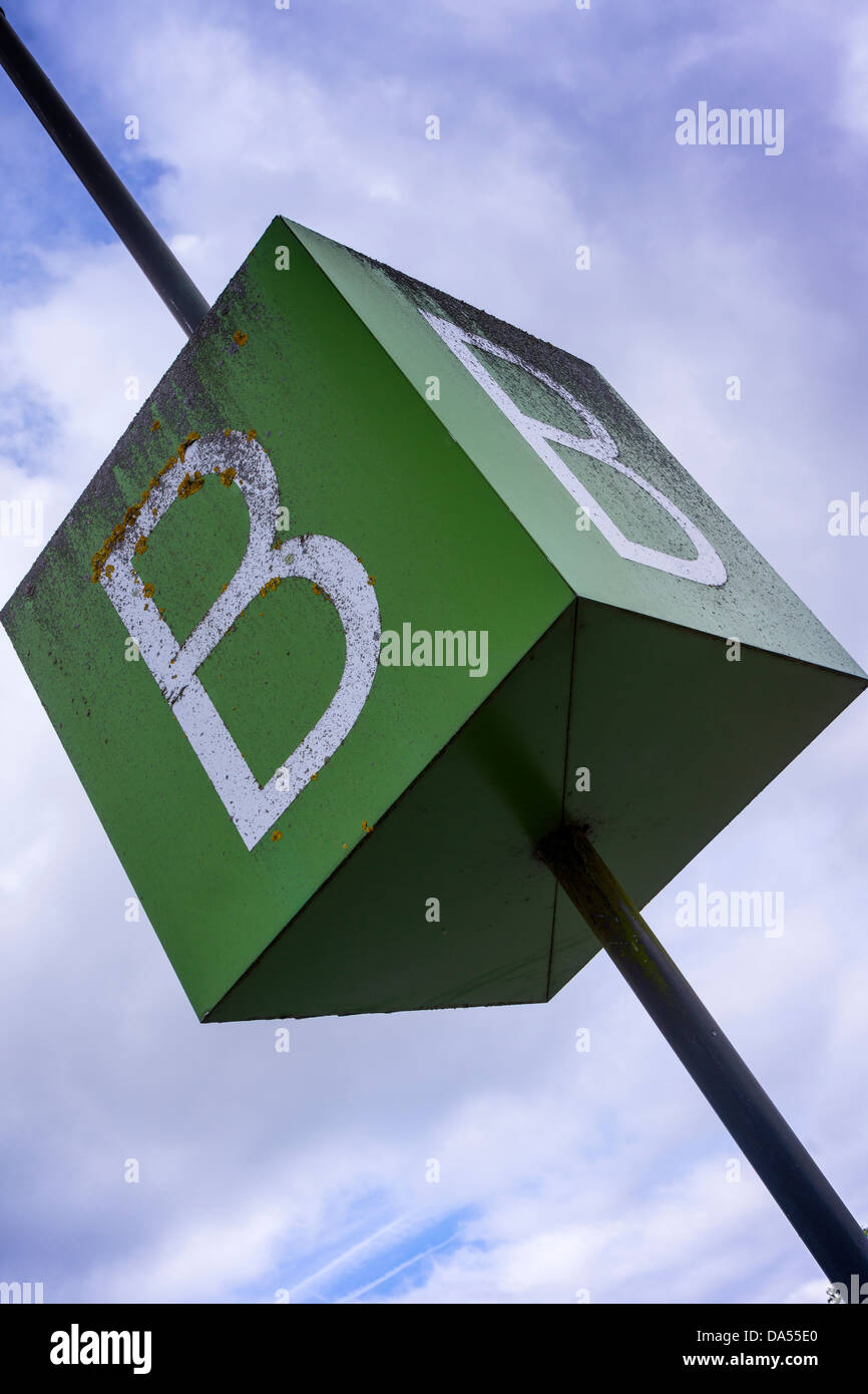 The letter B on a green cube car park sign. - Stock Image