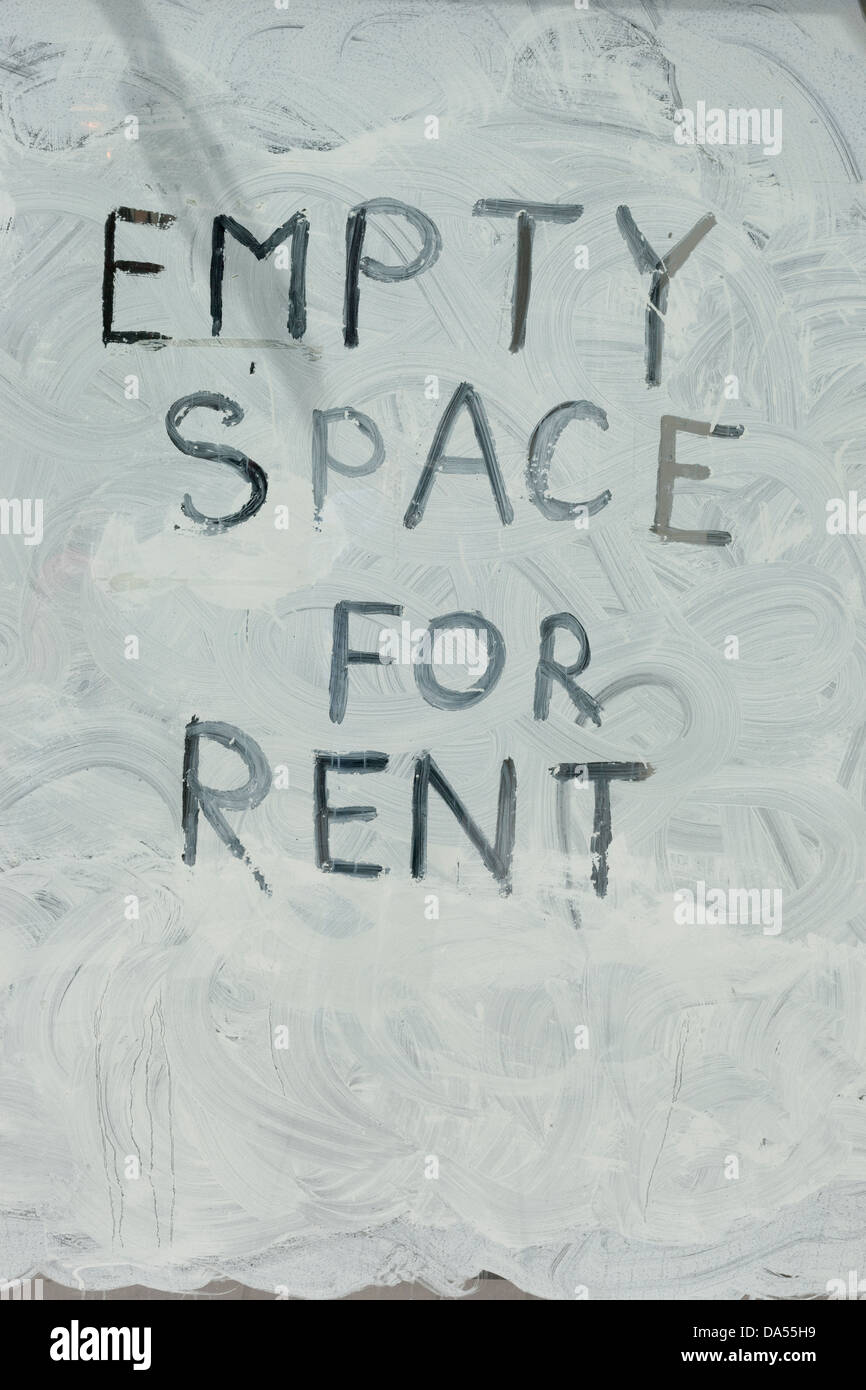 Empty space for rent written in a shop window. - Stock Image