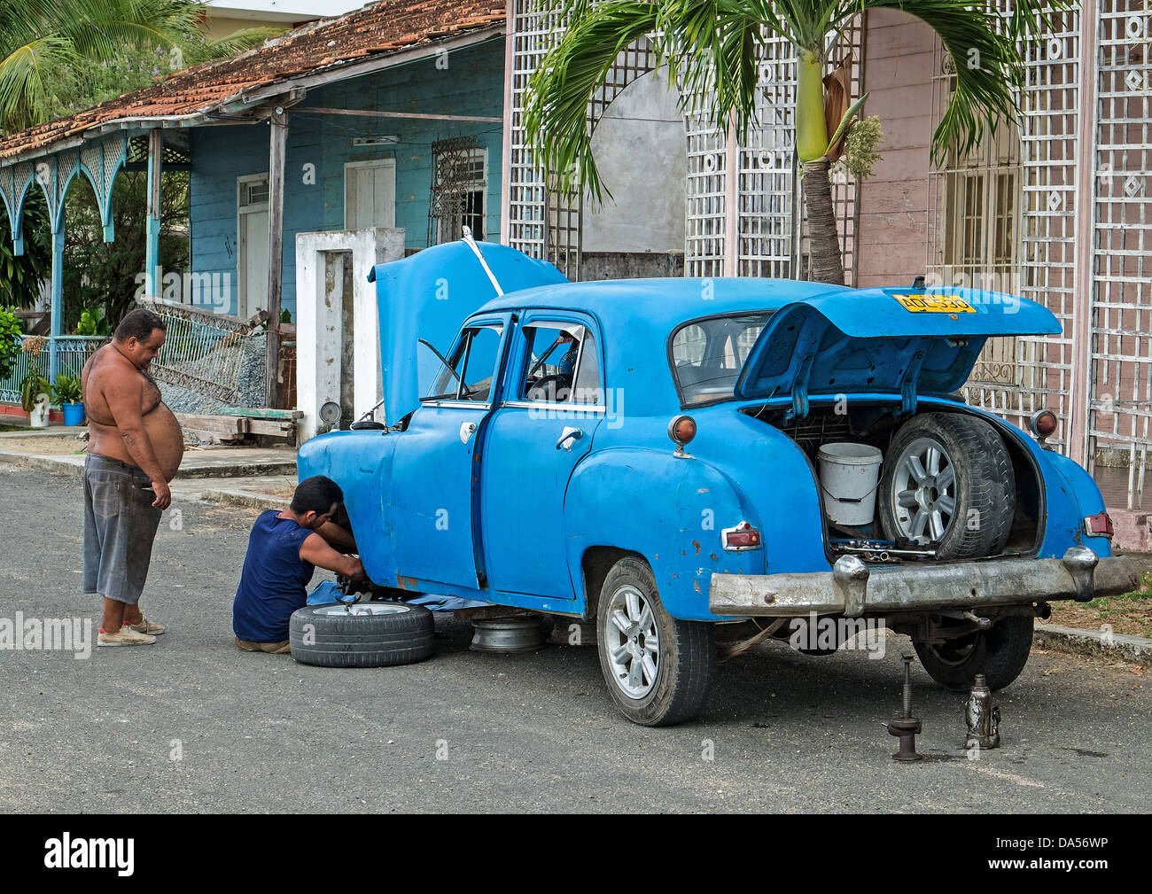 Old Automobile Being Fixed in Cuba - Stock Image