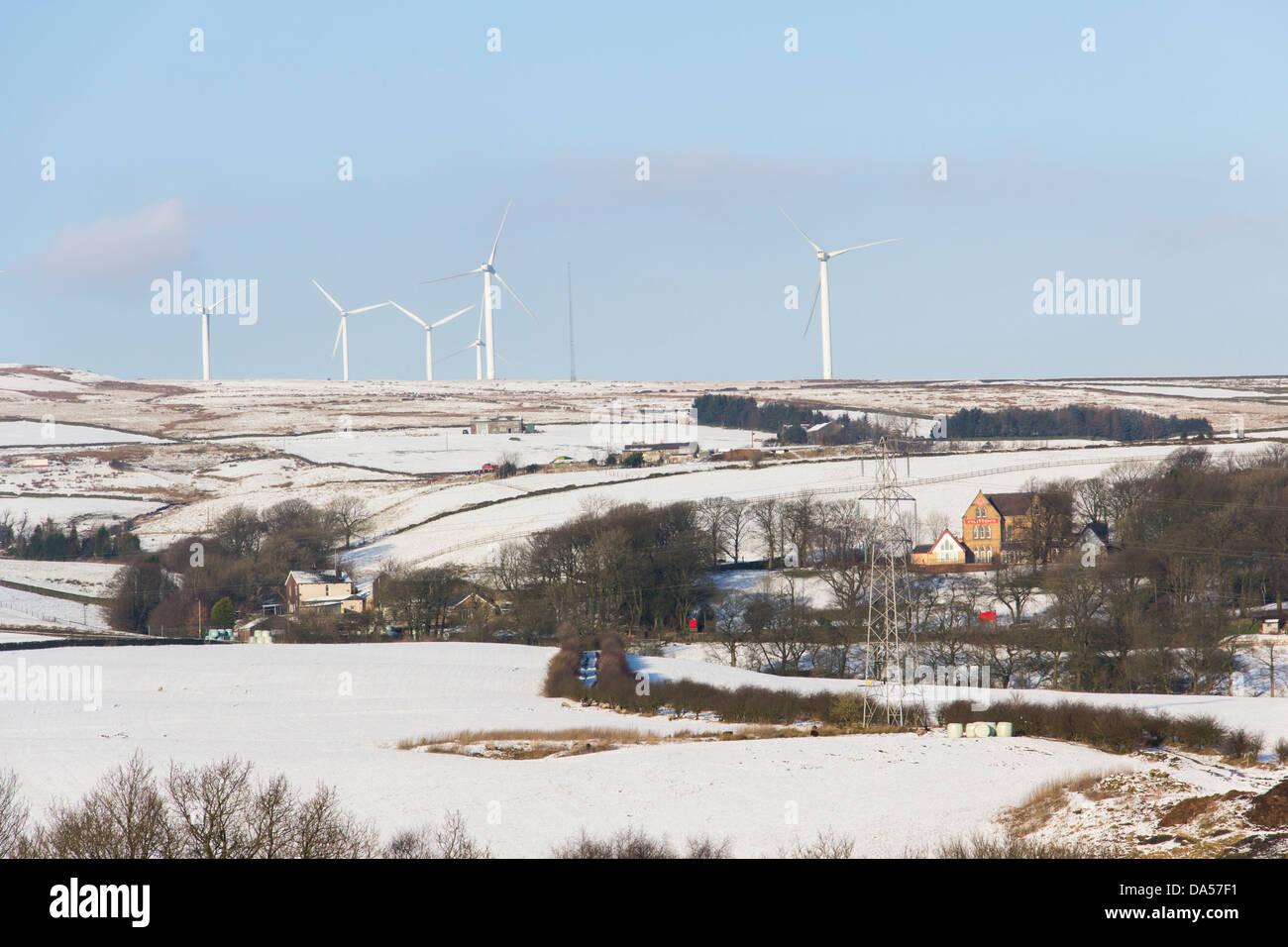 Wind turbines on Knowl Moor, overlooking Nutters restaurant, Edenfield Road, near Rochdale. - Stock Image