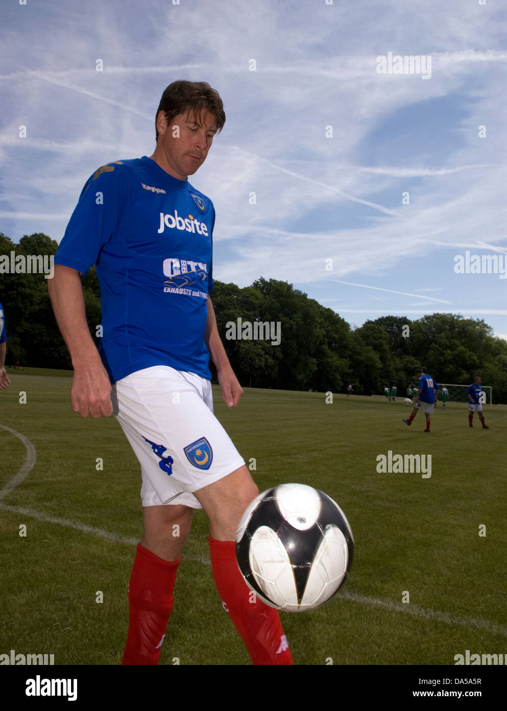 Former Portsmouth and England soccer player Darren Anderton warming up for an exhibition match, Fernhurst, Hampshire, - Stock Image