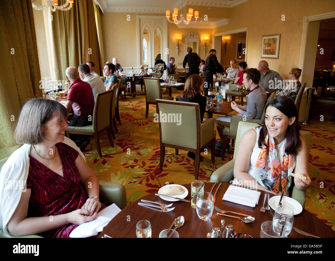 Guests in the dining room, the Marriott Sprowston Manor Hotel and Spa, Norwich, Norfolk England UK - Stock Image