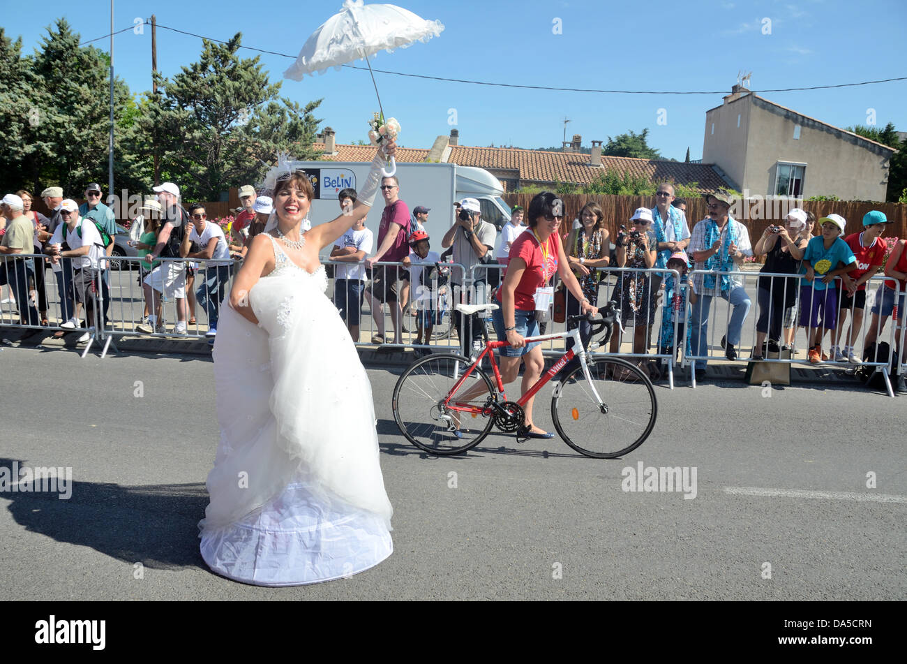 Provence, France. 04th July, 2013. Bride in Fancy Dress Parade Before the Start of the Tour de France Bike Race - Stock Image