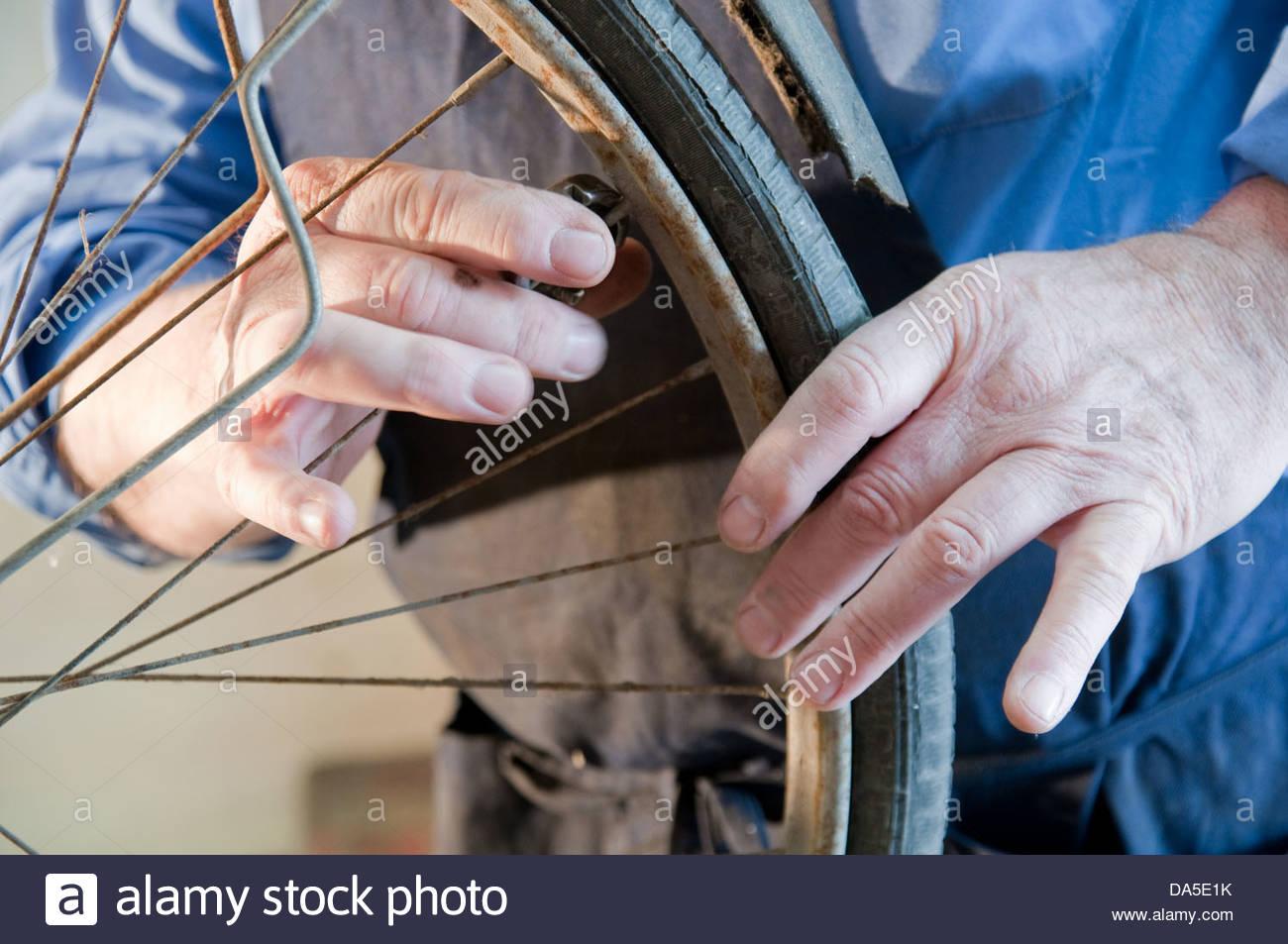 bicycle mechanic - Stock Image