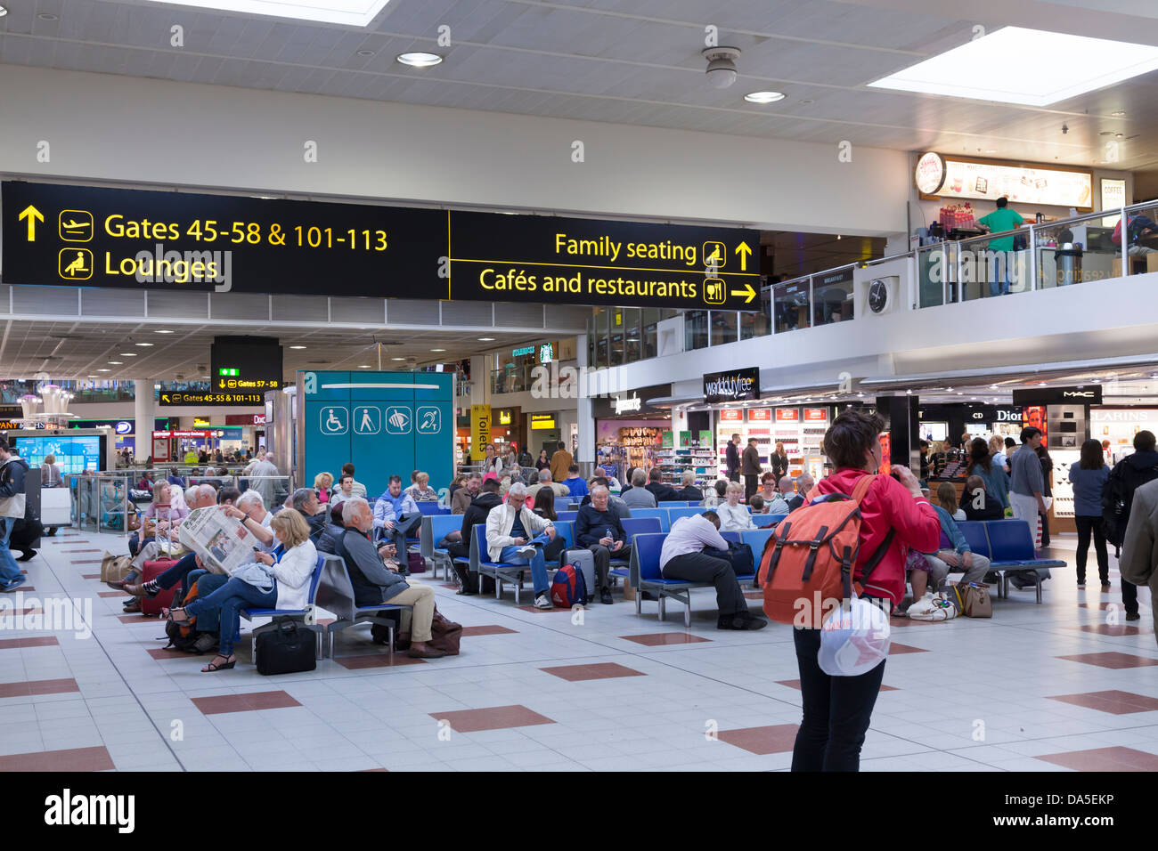 Gatwick airport departure lounge and direction signs - Stock Image