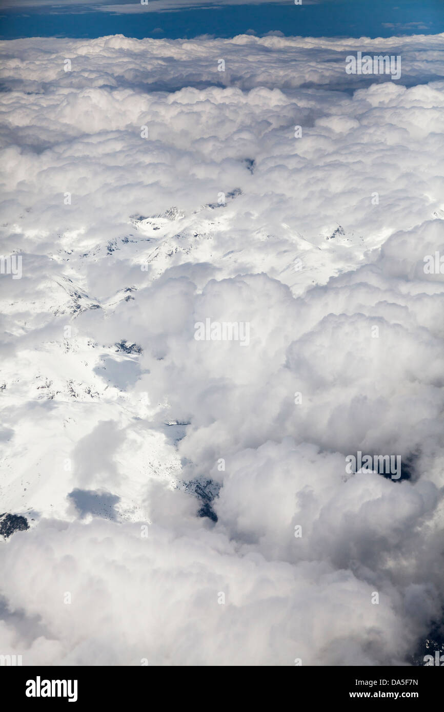 snow covered Pyrenees with cloud cover - Stock Image