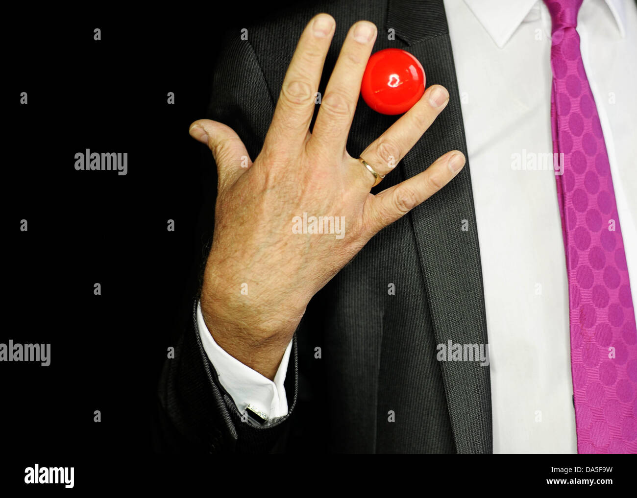 close up shot of magic trick against a black background - Stock Image