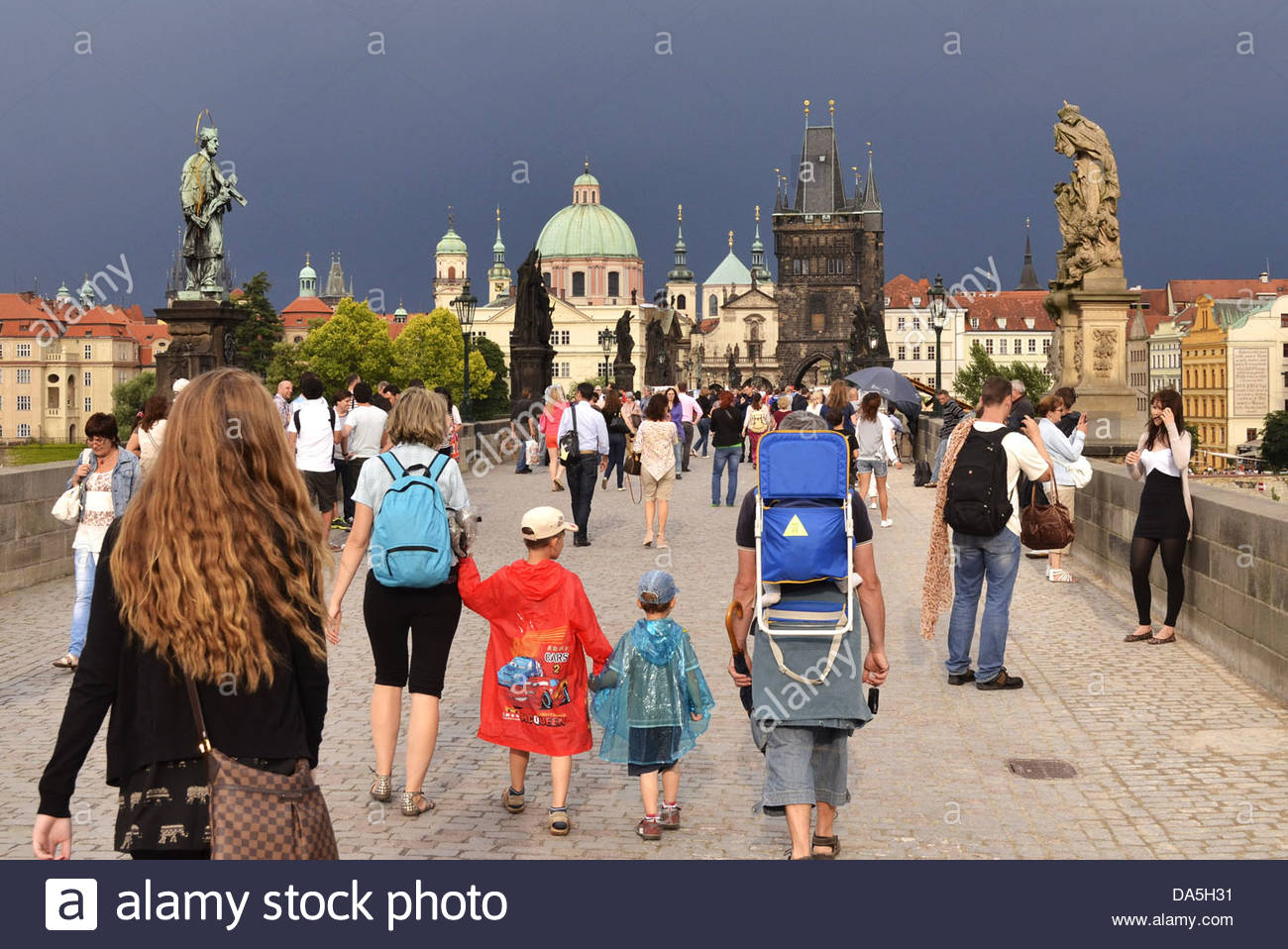 Prague Czech Republic - people walking across the historical Charles Bridge - Stock Image