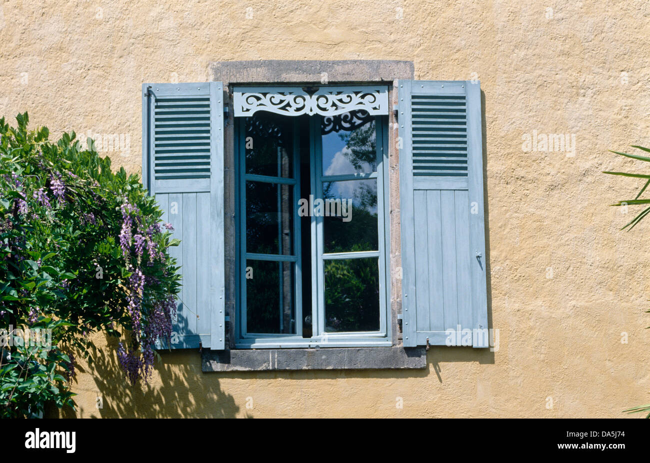 Close Up Of Blue Shutters On Window Of French Country House