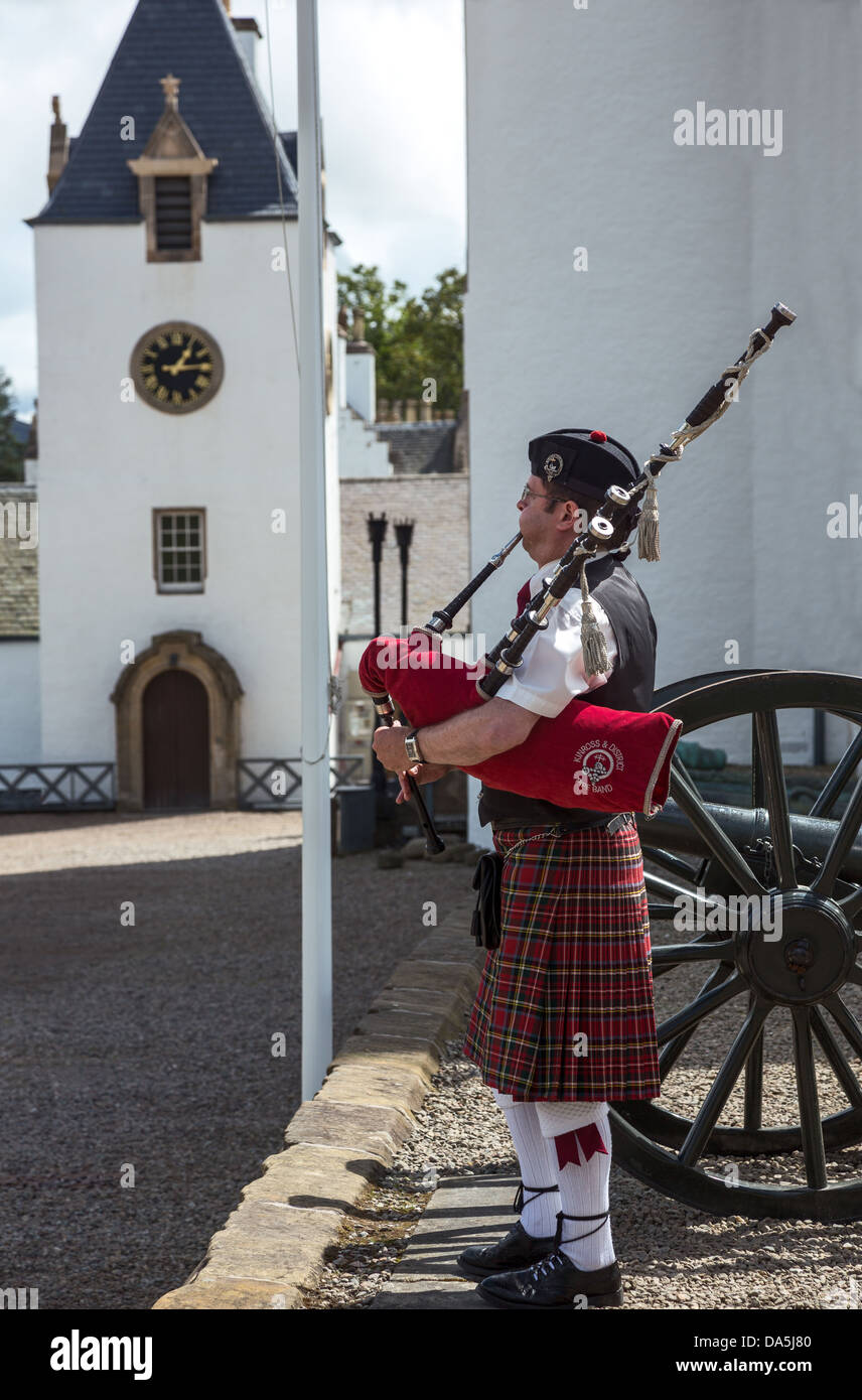 Europe Great Britain, Scotland, Perthshire, Blair Atholl, a piper in the Blair castle. - Stock Image
