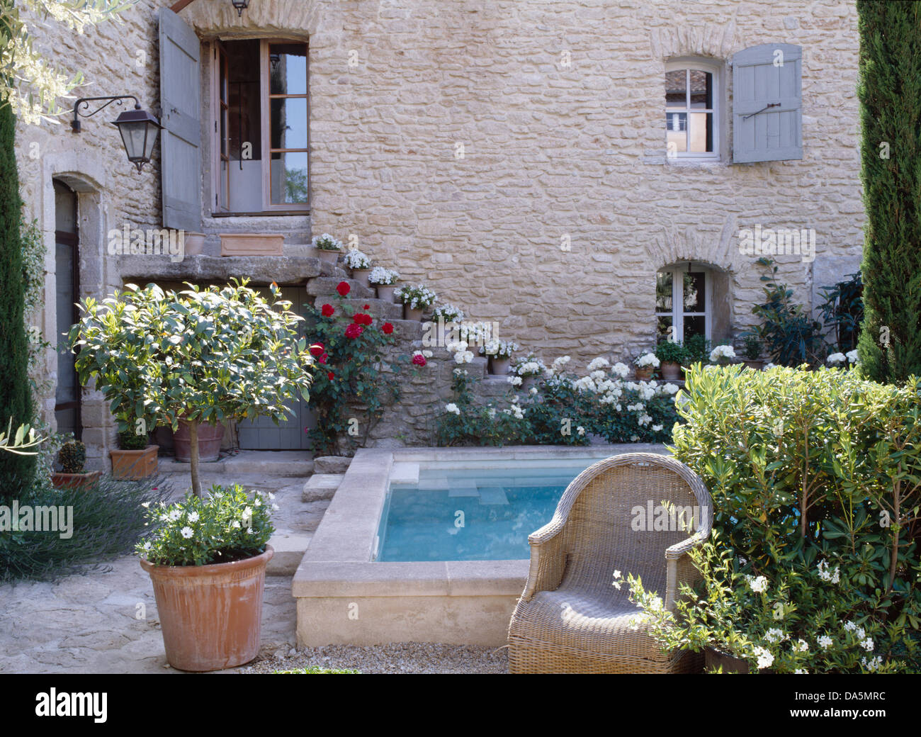 Small Swimming Pool In Courtyard Of French Country House With Bay