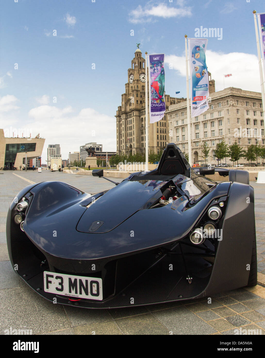 The BAC Mono, on Liverpool's historic waterfront, with the Cunard building and Liver building in the background - Stock Image