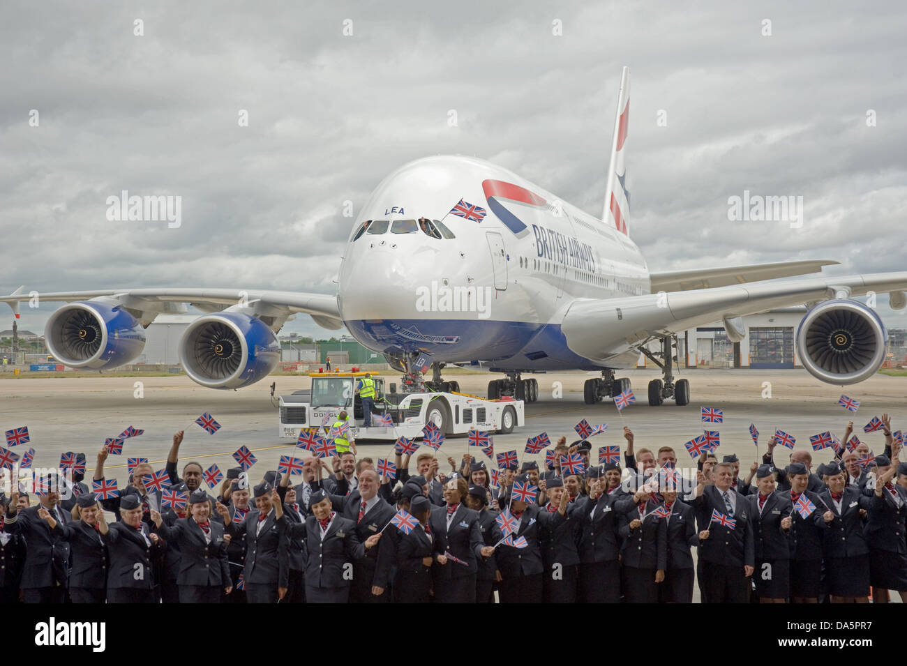 British Airways staff greet the airline's first Airbus A380 at Heathrow after it flies in from the factory in - Stock Image