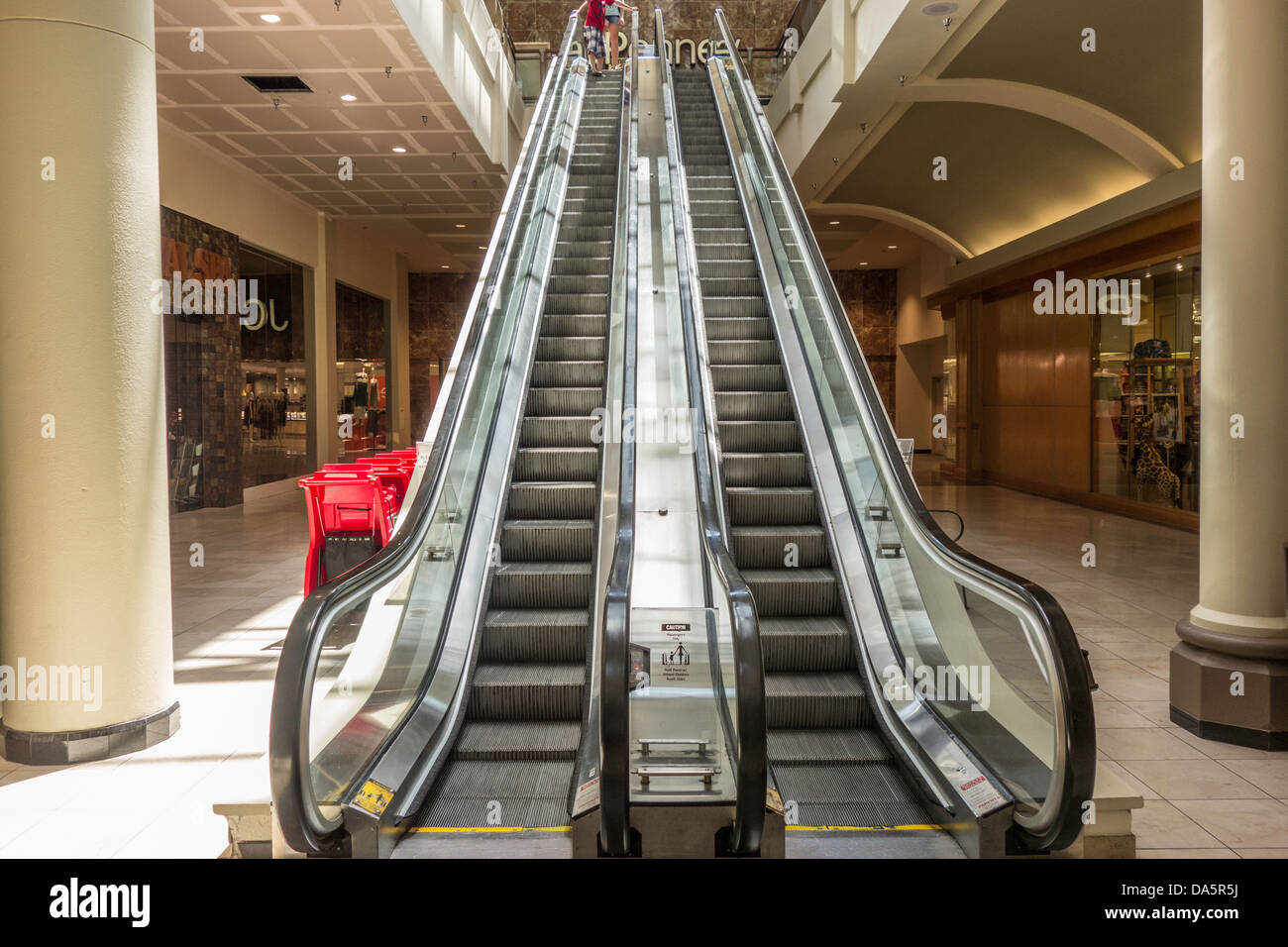 An escalator in a shopping mall. - Stock Image