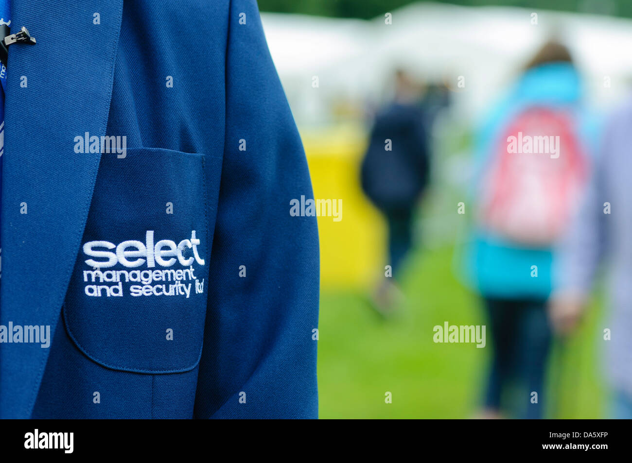 Security guard wears a formal uniform for Select Security, a provider of security and event staff in Northern Ireland. - Stock Image