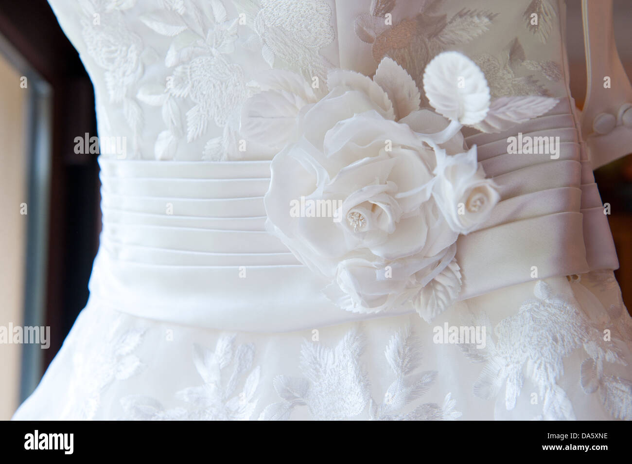 A Closeup Crop Of A Bride S Wedding Dress With Sash And Fabric