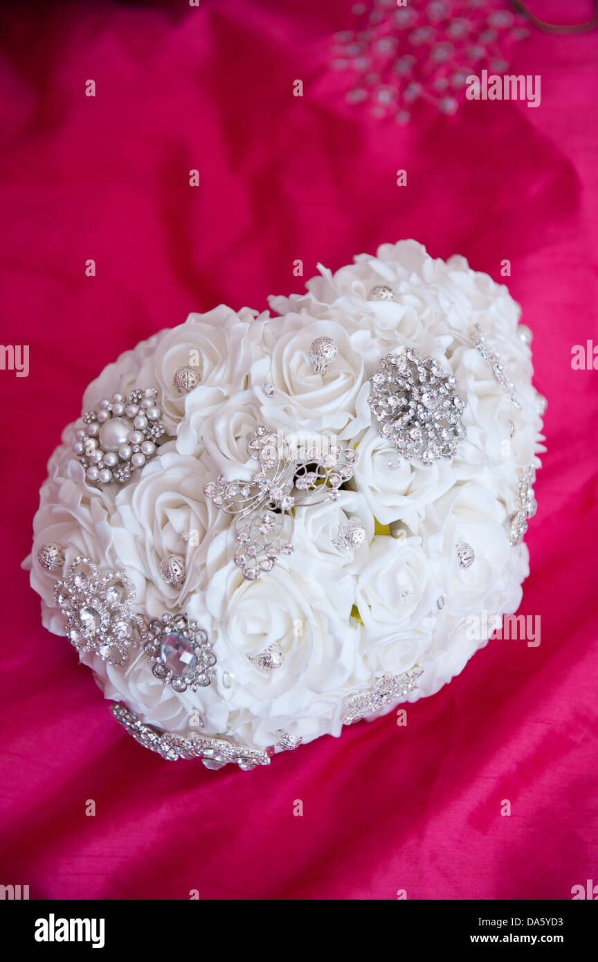 White fabric rose and brooch bridal wedding bouquet with butterfly white fabric rose and brooch bridal wedding bouquet with butterfly and flower diamant detailing on a vibrant pink background mightylinksfo