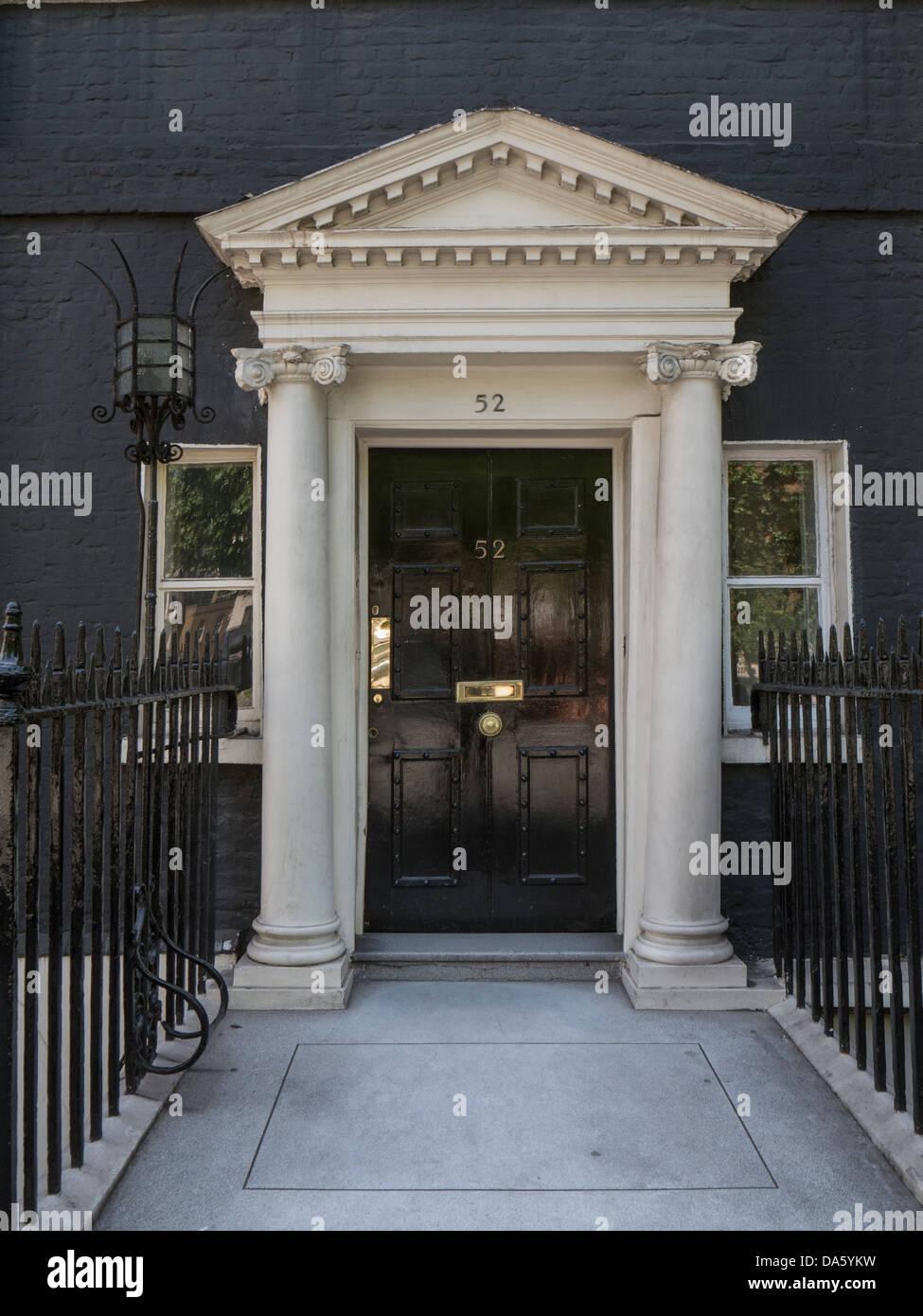 Door to Georgian house in Mayfair, London - Stock Image