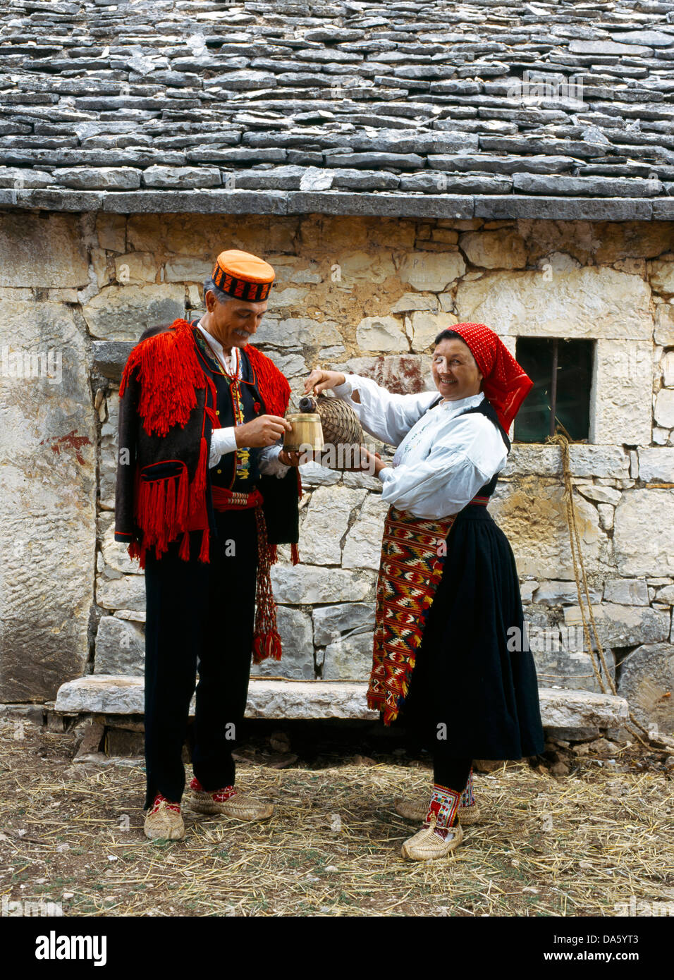 Central dalmatia croatia pakovo selo village couple in traditional dress
