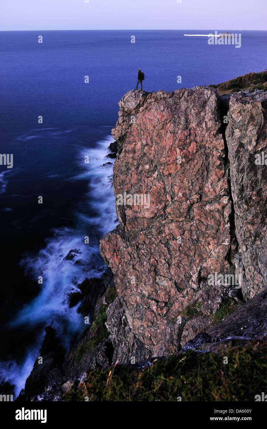Hiker, standing, edge, high, cliff, ocean, night, Long Point Lighthouse, Crow Head, Newfoundland, Canada, Stock Photo