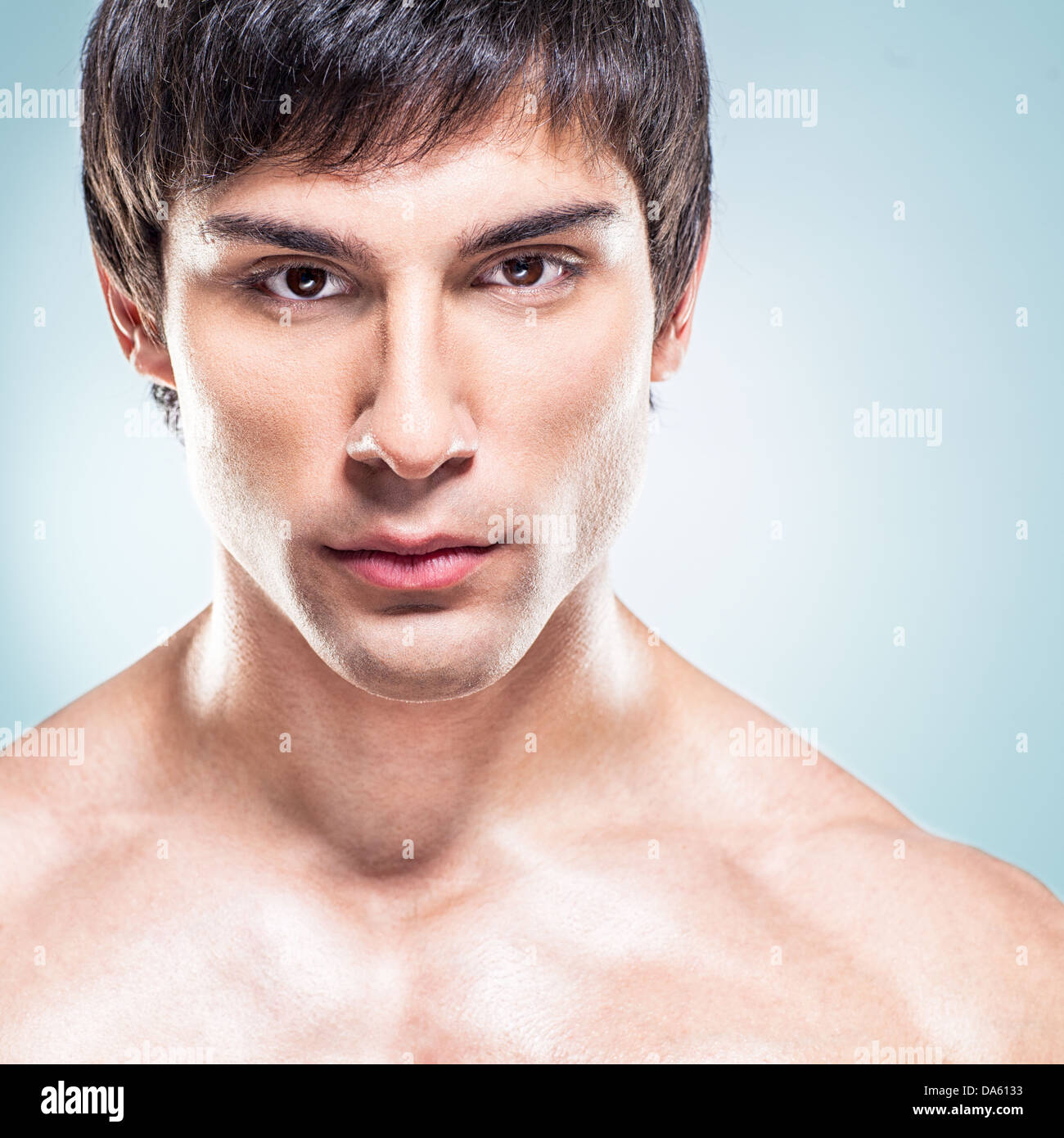 A Handsome Male Model Posing In Front Of A Blue Background Stock Photo Alamy