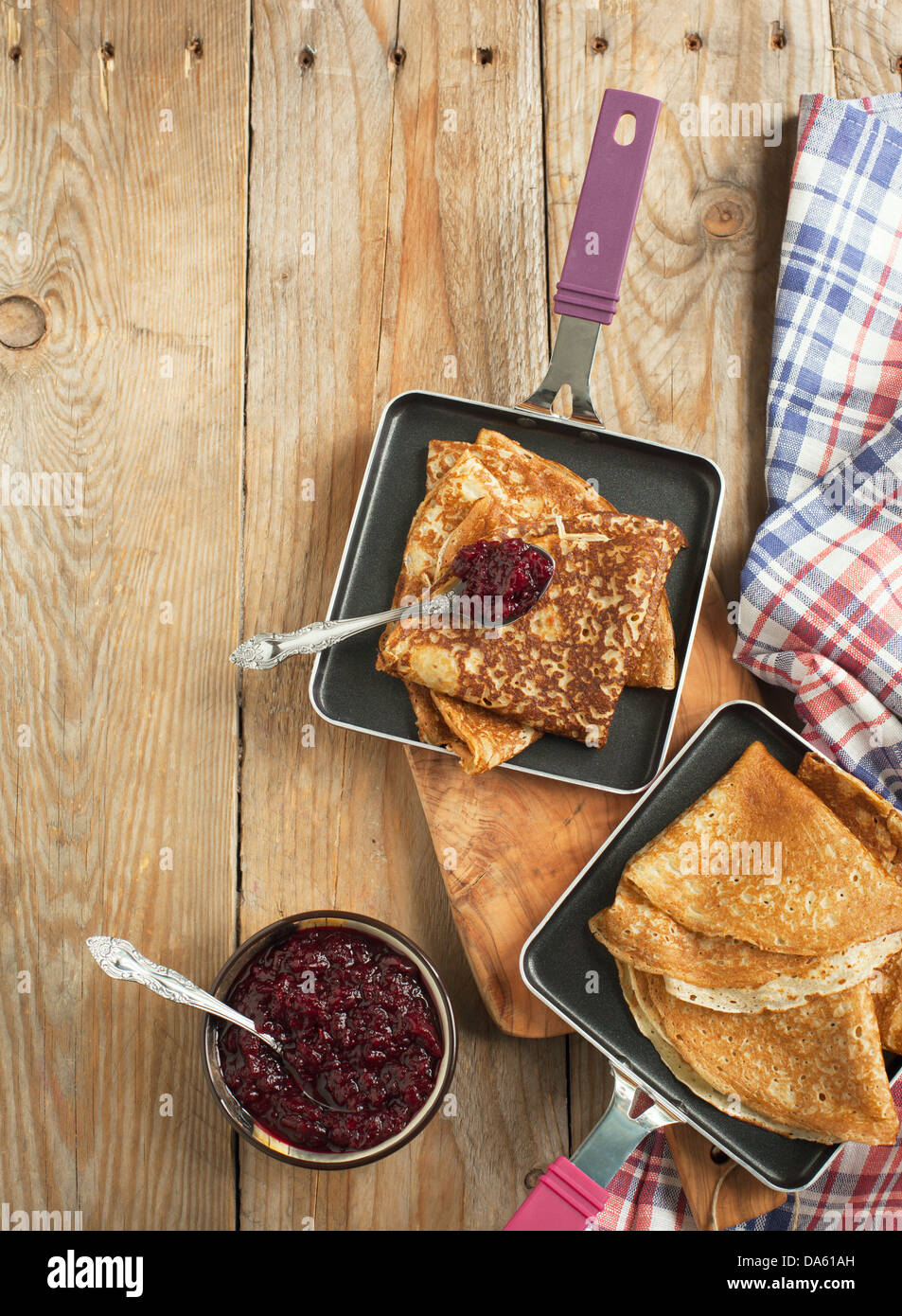 Crepes with black currant jam Stock Photo