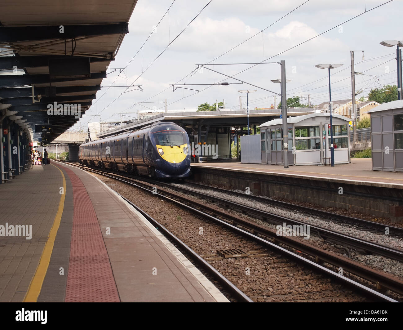 A Hitachi bullet train owned by Southeastern trains on the platform at Ashford International station - Stock Image