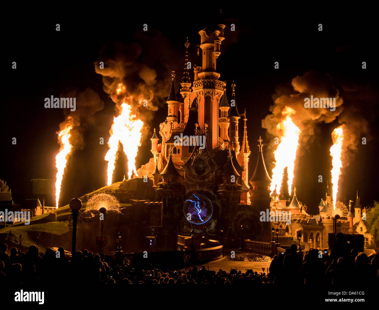 Flames rise up above Sleeping Beauty's castle at Disneyland Paris during the 20th anniversary Dreams show . - Stock Image