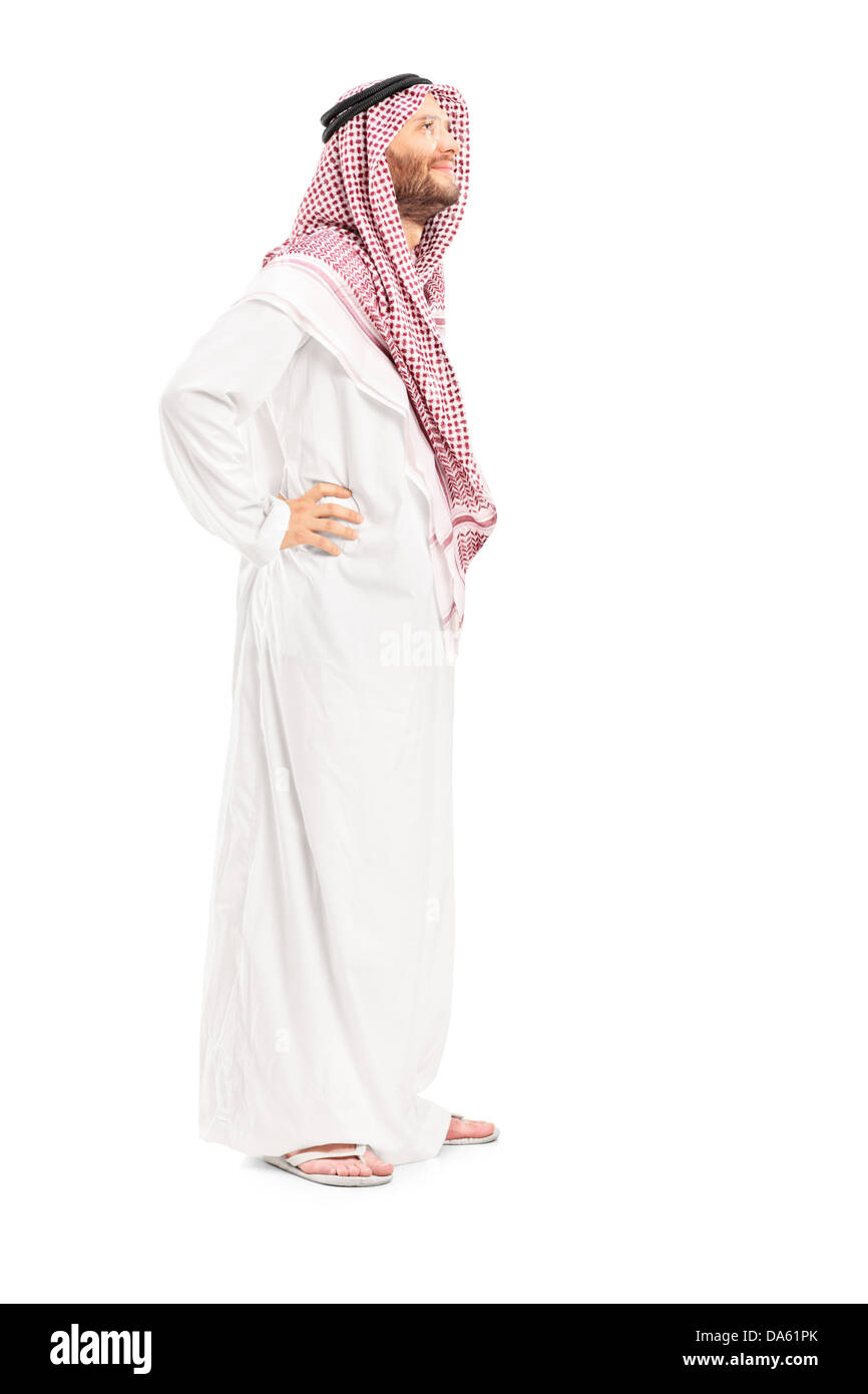 Full length portrait of a male arab person standing isolated on white background - Stock Image