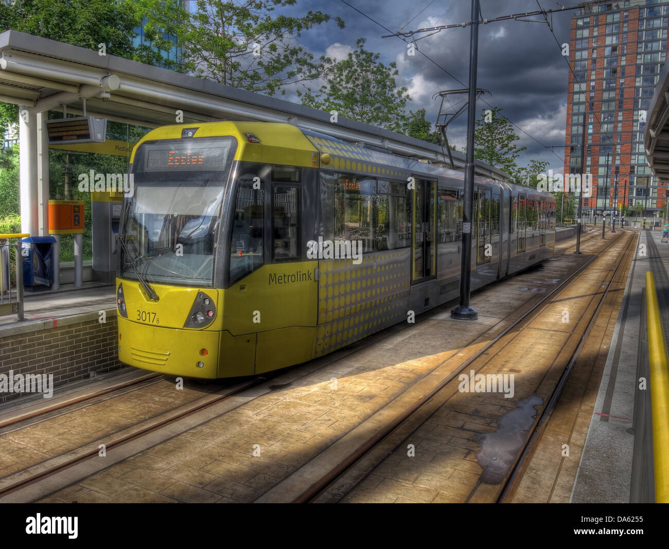 Yellow Tram at Media City Metrolink Station , Salford Quays , Manchester, England UK - Stock Image