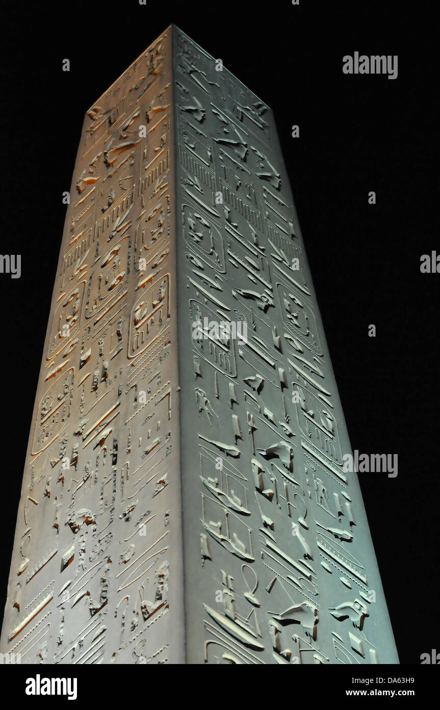 Huge obelisk at night at the Luxor Temple in Egypt Stock Photo