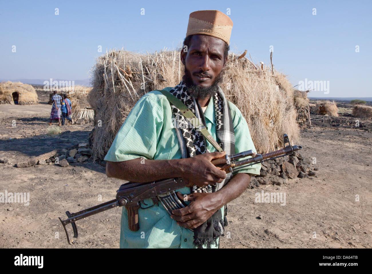 Volcano, Ertale, volcanical, Africa, hut, guard, man, submachine gun - Stock Image