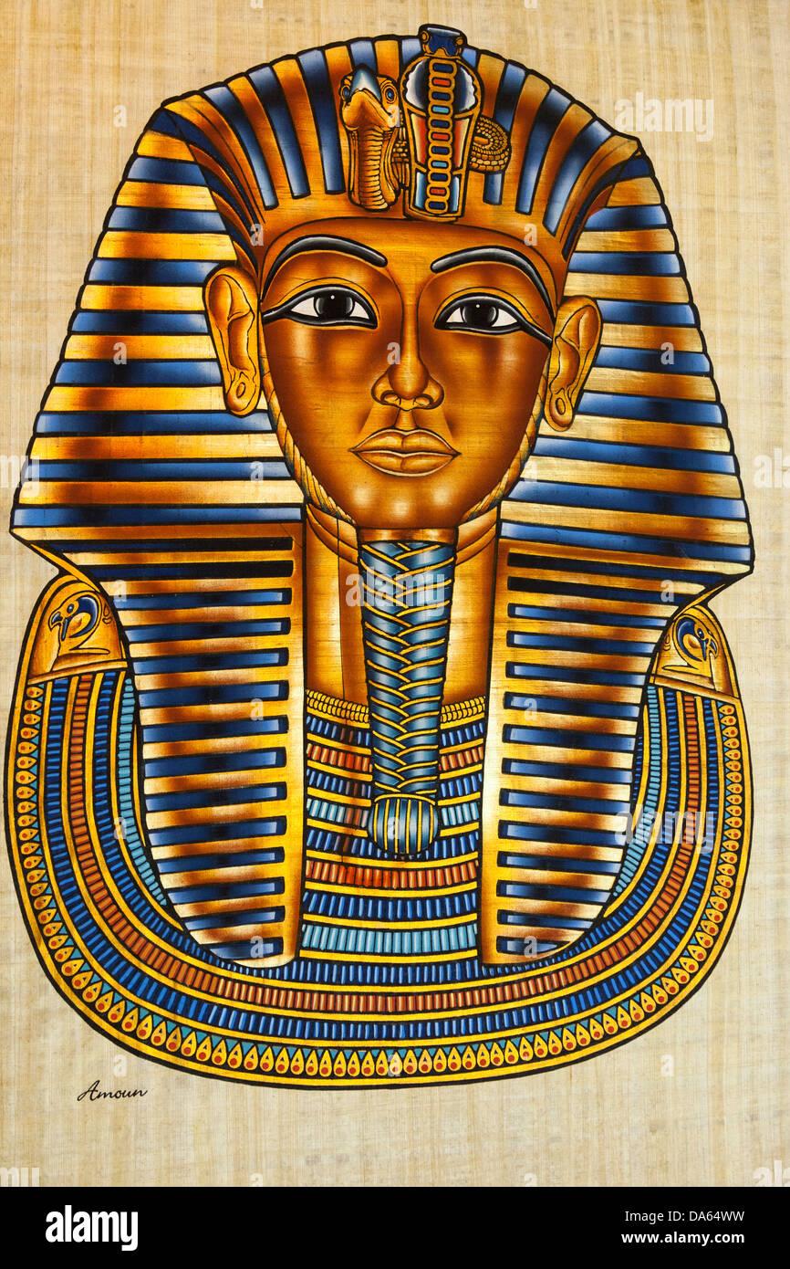 Painting of Tutankhamun's death mask on papyrus paper, Cairo, Egypt - Stock Image