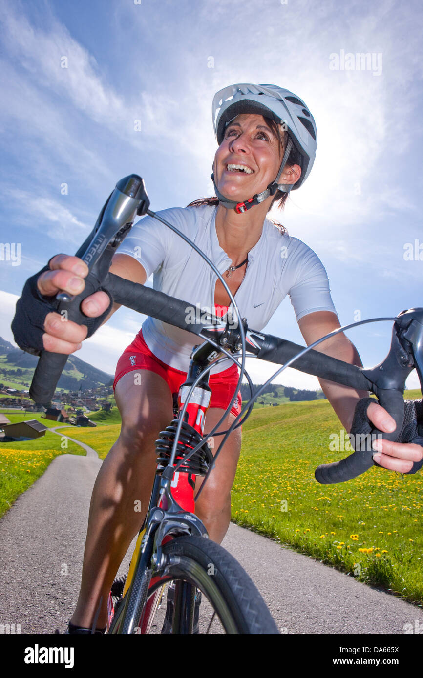 Cyclist, biker, Appenzell area, spring, bicycle, bicycles, bike, riding a bicycle, canton, Appenzell, Innerroden, - Stock Image