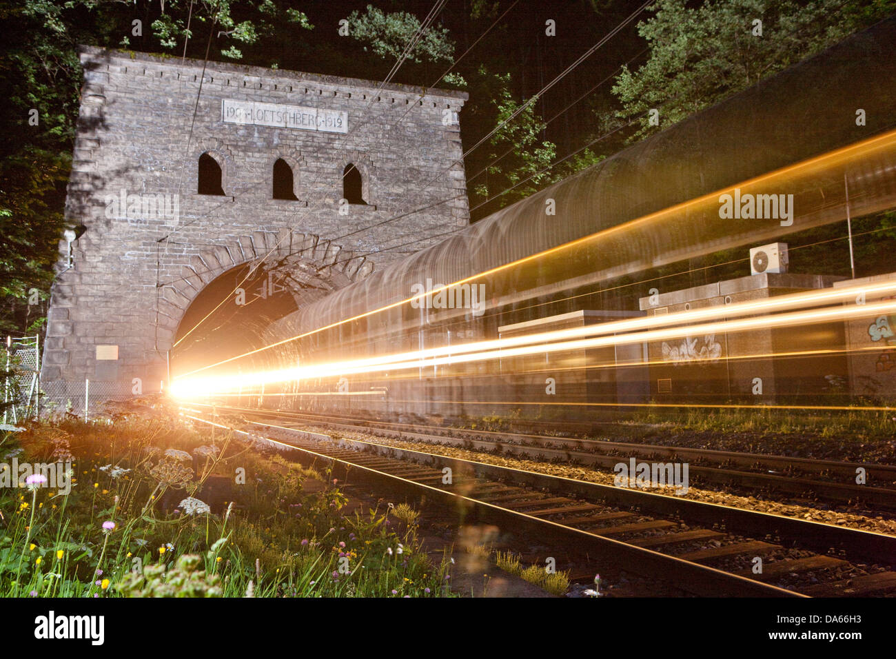 North main entrance, tunnel, Kandersteg, road, railway, train, railroad, Lötschberg, BLS, Switzerland, Europe, - Stock Image