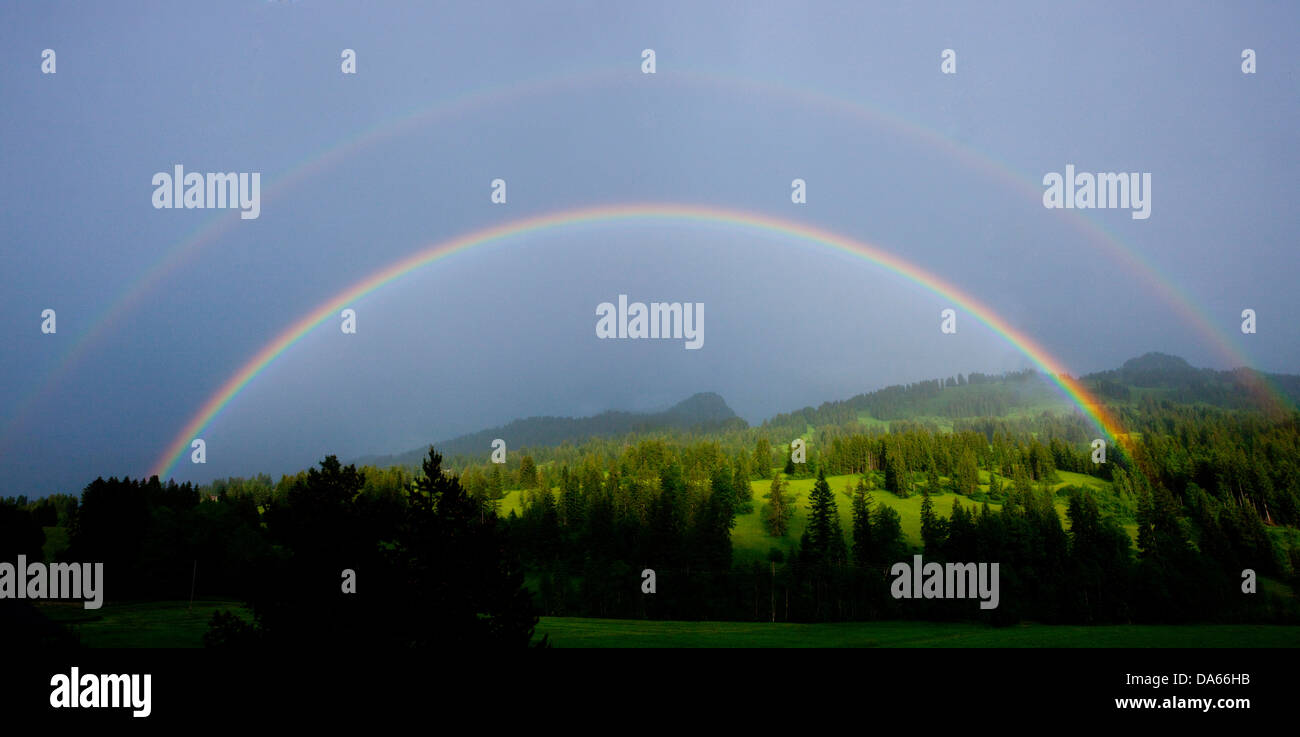 Rainbows, Saanenland, weather, clouds, cloud, canton, Bern, Saanenmöser, Gstaad, wood, forest, panorama, Switzerland, - Stock Image