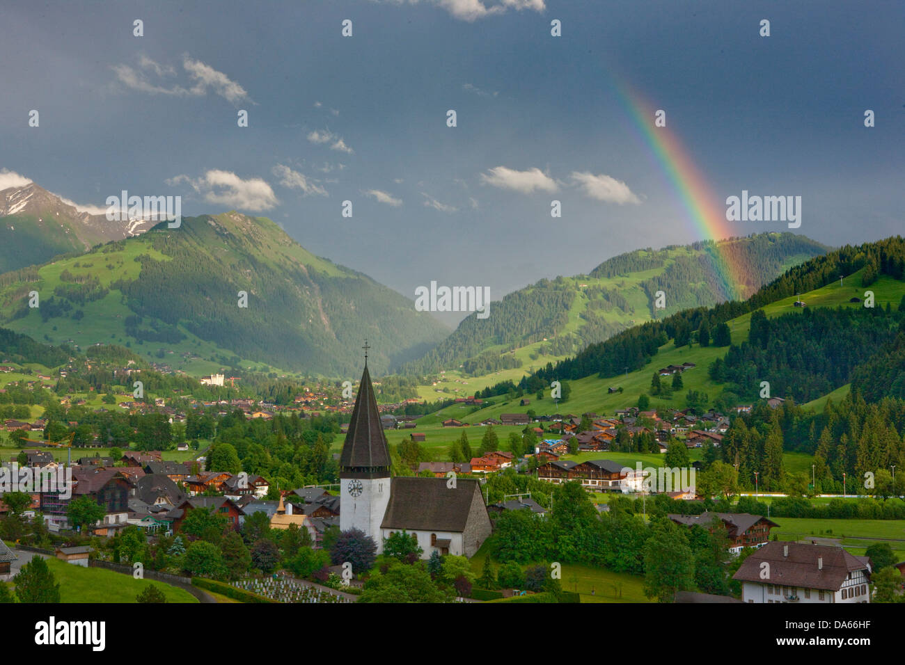 Rainbows, Saanenland, weather, clouds, cloud, canton, Bern, wood, forest, Gstaad, Switzerland, Europe, Bernese Oberland - Stock Image