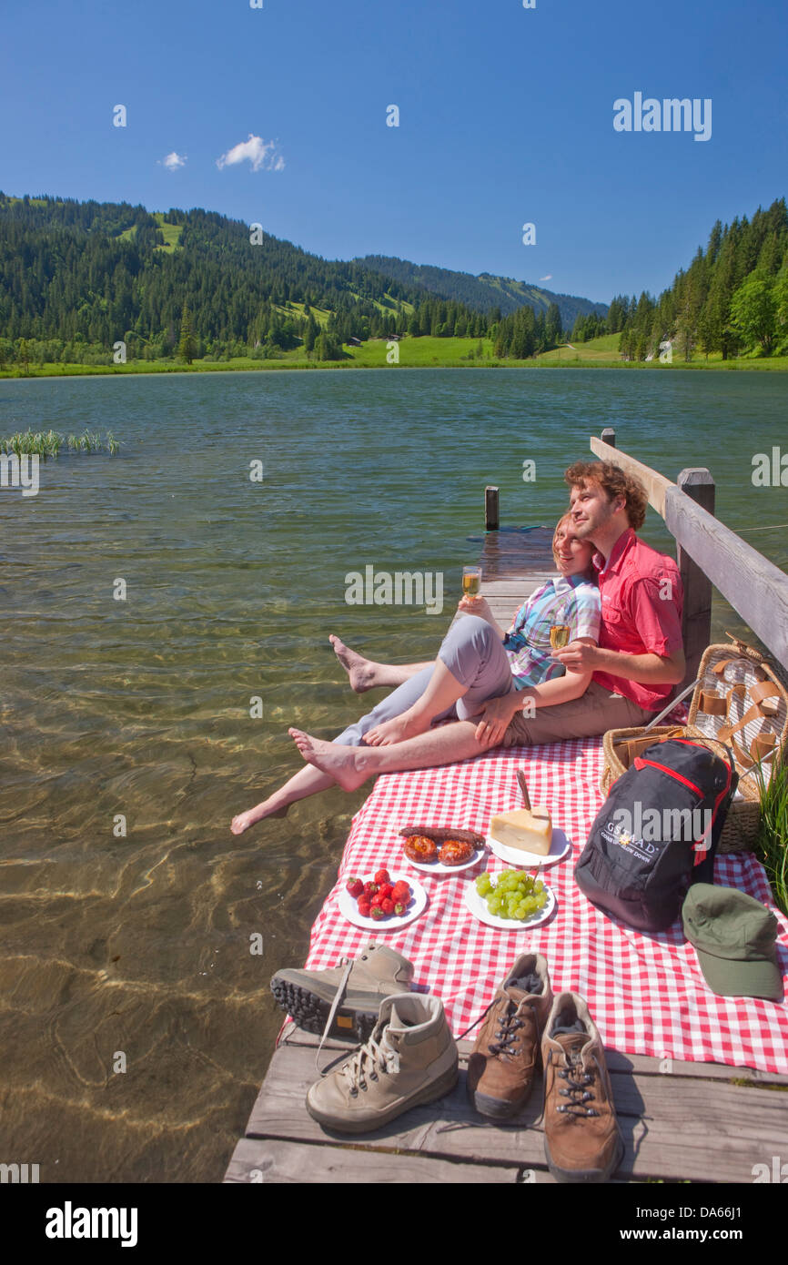 Traveller, picnic, Lauenensee, canton, Bern, couple, Couples, mountain lake, lake, lakes, footpath, walking, hiking, - Stock Image