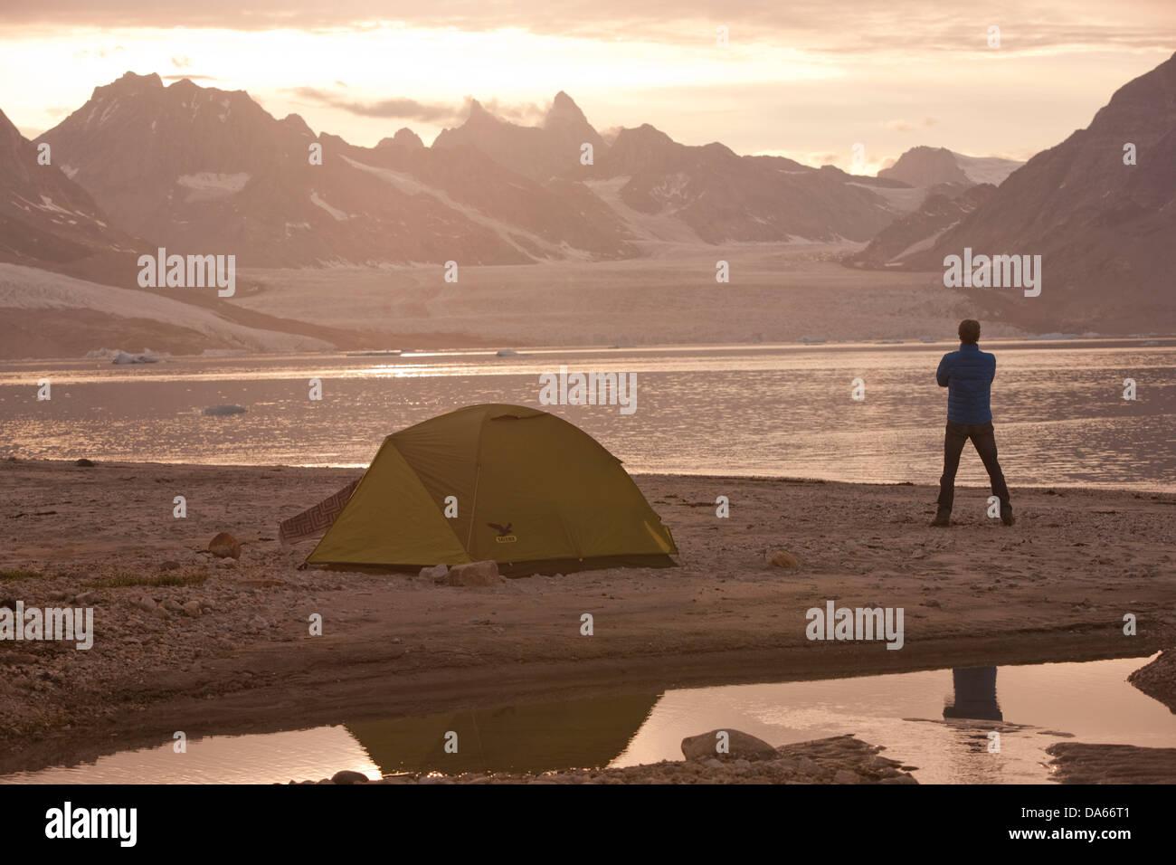 Camping, Karale, Greenland, East Greenland, glacier, ice, moraine, man, tent, trekking, Sermiligaaq, - Stock Image
